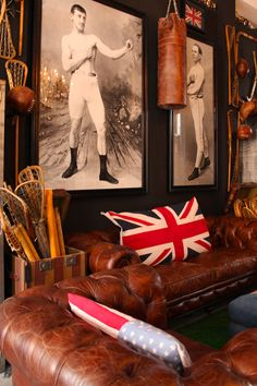 vintage chesterfield couches with Old Glory and Union Jack flag scatter cushions in Timothy Oulton shop