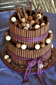 Wedding cakes: Chocolate Cigarillos Plus Balls Ornament Also Romantic Purple Ribbons On Elegant Cake Design 904, chocolate cigarillos for baking, chocolate cigarellos cake ~ MoviesFriend.Com