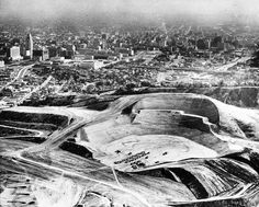 They literally moved mountains to create Dodger Stadium. Between 1959 and 1962, an army of construction workers shifted eight-million cubic yards of earth and rock in the hills above downtown Los Angeles, refashioning the rugged terrain once known as the Stone Quarry Hills into a modern baseball palace.