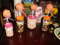 DIY Candy Jars- drilled hole in center, used cookie sticks, styrofoam ball with yarn instead of felt (time crunch lol), tops of lids with buttons, a little ribbon here and there and of course the candy;)