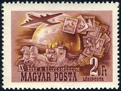 Aircraft, mail coach and stamps in front of globe