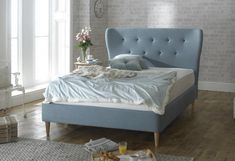 Retro looking bed frame with oak tapered feet and stylish duck egg blue upholstered fabric. Features a high padded headboard. Low foot end. Sizes: Double x King Size x or Super King x Manufactured by Limelight. Similar to Alam. Super King Bed Frame, Fabric King Size Bed, Duck Egg Blue Fabric, Buy Beds Online, King Single Bed, Single Beds, Retro Bed, Superking Bed, Upholstered Bed Frame