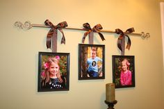 Curtain rods used to hang photos... Do this with wedding photo and a photo of each boy, above the headboard!