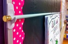Great way to hang up anchor charts. a tension rod, command hooks, and binder rings.