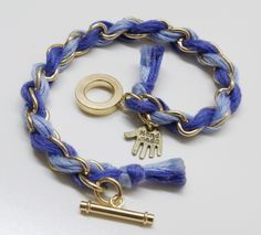 Armband in violett und gold