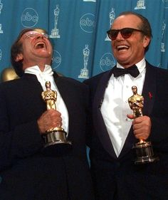 Robin Williams and Jack Nicholson share a laugh as they pose with their Oscars at the 70th annual Academy Awards at the Shrine Auditorium in Los Angeles on March 23, 1998.