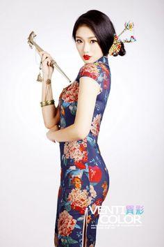 Sexy Chinese Girl in Silk CheongSam Dress