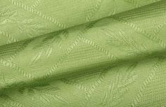 Add a tropical element to your design project with this gorgeous green linen upholstery fabric