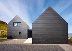 Black-stained house by Dualchas Architects completed on the coastline of a Scottish island.
