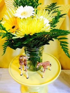 Floral decoration at a giraffe baby shower party! See more party planning ideas at CatchMyParty.com!