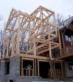 The larger, lake facing addition used traditional scissor trusses and includes additional loft space off the master bedroom with a unique, square lookout perch. Timber Architecture, Timber Buildings, Architecture Details, Timber Frame Homes, Timber Frames, Concrete Sheds, Framing Construction, Medieval Houses, Gambrel