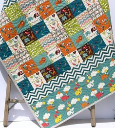 READY TO SHIP! This modern quilt was created using Safari Soiree by Dan Stiles for Birch Organic Fabrics which is 100% GOTS certified organic cotton. The colors blend so well, brown, orange, dark plum, teal, grey, green and hints of coral pink. It measures approximately 39 by 44