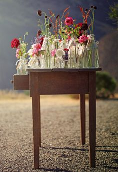 See you tomorrow.: たくさんのガラス瓶と花