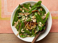 Sweet and crunchy snow peas are as light and healthy as they are tasty--save time by using a purchased low-sodium stir fry sauce.