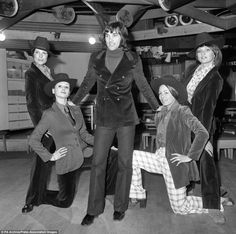 "Manchester United soccer star George Best surrounded by the ""Gangsters"", four Manchester models. Left to right, Carolyn Moore, Kathy Anders, Verena and Mandy Preston."