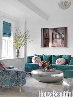 A bold family room. Design: Fawn Galli. housebeautiful.com. #teal #family_room #silver #bright_colors