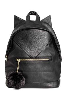 Backpack: Backpack in grained imitation leather with sewn-on ears, a handle at the top, adjustable shoulder straps and a padded back plate. Zip at the top and one zipped outer compartment decorated with a faux fur pompom. Black Leather Backpack, Rucksack Backpack, Leather Bag, Stylish Backpacks, Cute Backpacks, College Bags, H&m Fashion, Cute Bags, Luxury Bags