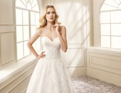 Eddy K. style - EK1063: A-line, strapless, sweetheart neckline, tulle and corded lace wedding dress. Available in Ivory