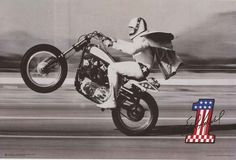 Shop for Evel Knievel Wheelie Poster x with Contemporary Poster Frame - Black. Get free delivery On EVERYTHING* Overstock - Your Online Art Gallery Store! Hd Vintage, Vintage Frames, Motorcycle Posters, Motorcycle Bike, Motocross Bikes, Vintage Motocross, Harley Davidson News, Harley Davidson Motorcycles, Cool Motorcycles
