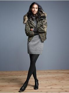 Match tights to booties or skirt to keep the visual line long and lean. Image credit: Gap