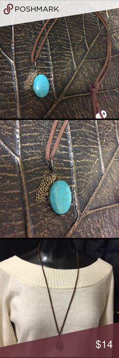 Turquoise clasp pendant with gold tassel Necklace Turquoise pendent with gold tassel on a brown leather necklace. One size fits all. One of a kind in my hand made collection 💖 Torque by Jennifer Jewelry Necklaces