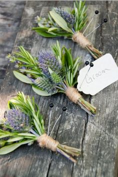 The rest of the boutonnieres will be blue thistles and gray dusty miller and a hint of white astilbe wrapped in gray ribbon with the stems showing.
