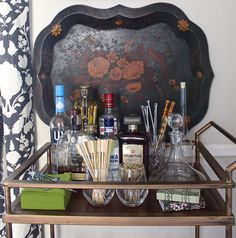 Elegant vintage cocktail tray or barware setup for bully-in sideboard in former dining room.  Maybe mix 20s, 30s, 40s vintage items (etched champagne coupes, Depression glass tumblers) with Art Deco streamlined cocktail shaker and accessories, on big elaborate handled silver tray?