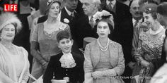 Queen Elizabeth with Prince Charles and Elizabeth II at Princess Margaret's wedding, 1960.