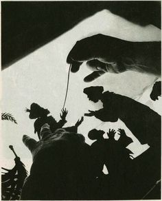 Lotte Reiniger moving one of her Silhouette cuts, then photographing it, frame by frame to make a Silhouette animation. She was a pioneer in this type of animation, and had the first full length animated film (not Disney!)