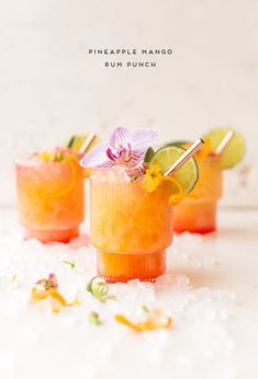 This pineapple mango rum punch recipe can be made individually or in batches and is inspired by the Caribbean. In partnership with (rum punch drink) Cocktails For Parties, Summer Cocktails, Party Drinks, Fun Drinks, Alcoholic Drinks, Beverages, Drinks Alcohol, Hawaiian Cocktails, Mixed Drinks