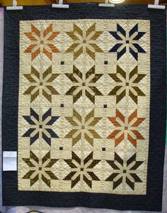 """Emblem, 63 x 80"""", by Rose Marquardt. Pattern by K. Jolly, S. Price, & J. Ueng in Fat Quarter Style, done here in Civil War fabrics. 2015 Sauder Village quilt show; photo by Fabric Therapy."""