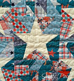 I had this big idea to take the scraps from the top of my mother's patriotic quilt and create a scrappy flag on the back, as I mentioned I w...