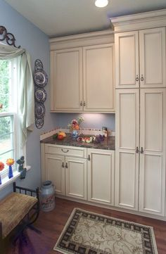 Clean Simple And Organized Laundry Room Design With Desk Seating From 1 Of 17 Projects By Riverland Homes Rooms