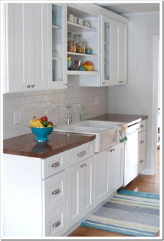white kitchen, butcher block countertops, subway tile
