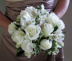 A simple hand-tied bridesmaid's bouquet we created of white roses, carnations and alstroemeria.