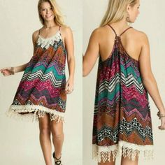 Breaking All the Rules Chevron Fringe dress- umgee Retail  Criss Cross Back  Adjustable drawstring in the back  65% Cotton, 35% Polyester Boutique Dresses Midi