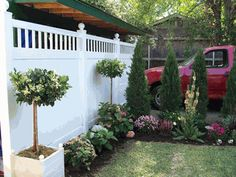 The Mason Vinyl Fence really compliments the beautiful landscaping! Definitely need to remember this picture!