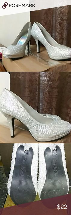 Silver Slipper Heels Beautiful Heels featuring Silver shimmery and shine throughout with rhinestones.. in excellent condition, worn once to prom silver slippers Shoes Heels