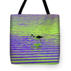 Baby Black Neck Stilt In The Pond Tote Bag by Tom Janca.  The tote bag is machine washable, available in three different sizes, and includes a black strap for easy carrying on your shoulder.  All totes are available for worldwide shipping and include a money-back guarantee.