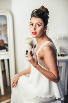 Classic red lips and winged eyeliner complete your timeless wedding look