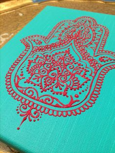 Red acrylic on turquoise canvas hamsa design by Henna on Hudson