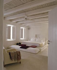 White walls & ceiling; white polished concrete floor                                                                                                                                                      More