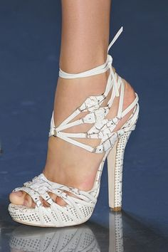 These strappy platform white snakeskin sandals are from Christian Dior