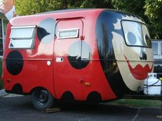 Oh my..my mother would have loved this...Ladybug trailer all dolled up.FUNNY