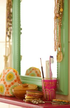 A pink Moroccan tea glass as cosmetic brush / toothbrush holder.... a perfect size for the dressing table.