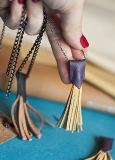 DIY Leather Tassel Necklace Tutorial from Sokeen.This is a different take on the tassel necklace I've been seeing everywhere. The top is molded to the tassel, not wrapped as usual. In my opinion this gives the necklace a more sophisticated look. The...