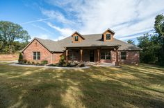 Arbor Meadows. Moore Schools. Beautiful new home w/ covered porch, dormers & landscaping.  The Ashford floor plan has been a very popular floor plan over the years and most recognized by the covered front porch. This plan offers 4 bedrooms, 2.5 bathrooms, utility room, fireplace, covered patio, bonus room & more. Beautiful kitchen with breakfast bar and pantry. Master suite with double vanity, tub, separate shower and walk-in closet! http://www.4cornershomes.com/ashford #4CornersHomes