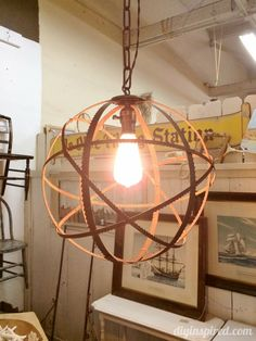 Repurposed Lighting with Saw Blades- Would be neat over the kitchen table.