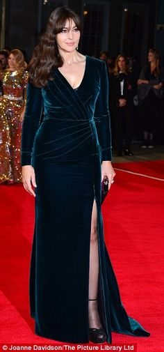 Picture perfect: The 51-year-oldwas the envy of all in a plunging emerald velvet gown which featured a thigh high split