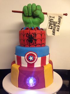 Avengers cake, with Rice Krispie hulk hand, and light up Iron man chest.